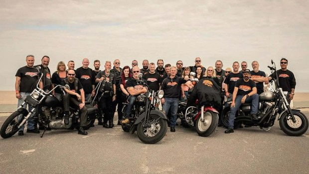 A group shot of the riders with their bikes