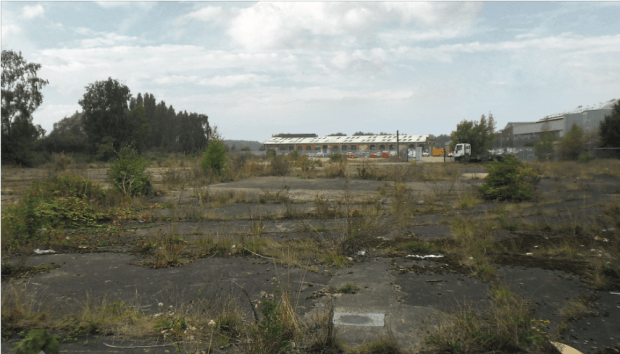 The site has been vacant since 2010, with the foundations of the former industrial building remaining.