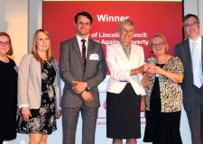 The award being presented to City of Lincoln Councillor Sue Burke, alongside Assistant Director Simon Walters, Principal Policy Officer James Wilkinson, Democratic Services Officer Claire Turner and Communications Officer Julie Lea.