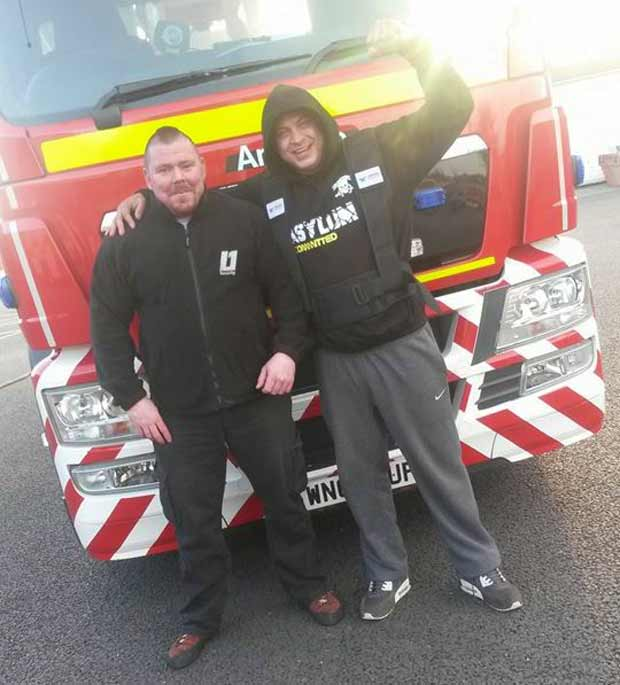 Dave (left) with Craig Collins, who'll be takling the fire truck pull this year.
