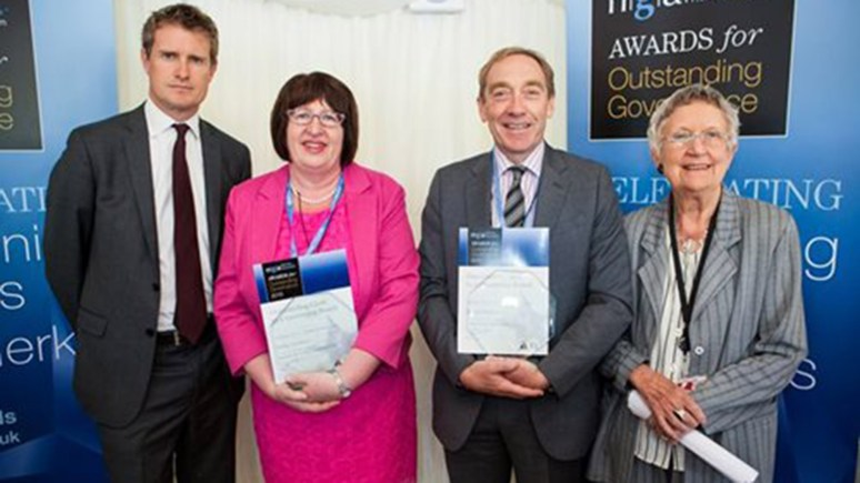 Sally Coulter (second from left) receives her the Outstanding Clerk to a Governing Body award