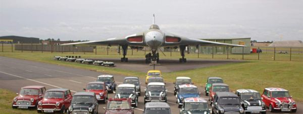 Mini enthusiasts from the Lincoln-based Bomber County Minis group at RAF Waddington with the XM607