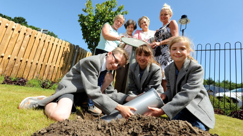 Staff, residents and local school children combined timely items to be uncovered in 100 years time. Photo: Stuart Wilde