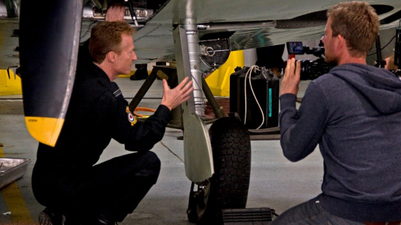 Flight Lieutenant Antony Parkinson of the Battle of Britain Memorial Flight, being filmed by a camera crew at RAF Coningsby, Lincolnshire, for a new BBC documentary series. Photo: MoD/Crown Copyright 2015