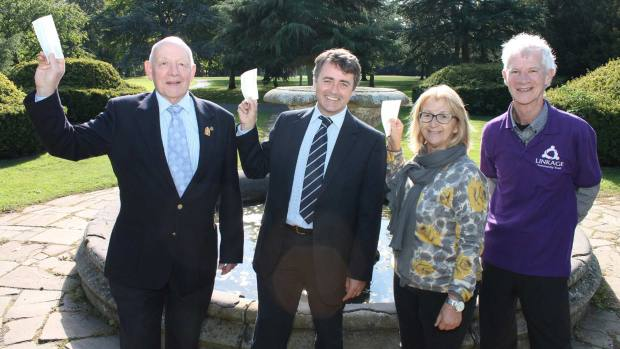 L-R: Richard Wright, Rotary Club of Lincoln Colonia, Steven Spivey of Mundys Estate Agents, and Jo Owens, Rotary Club of Lincoln Colonia, with Philip Barnatt