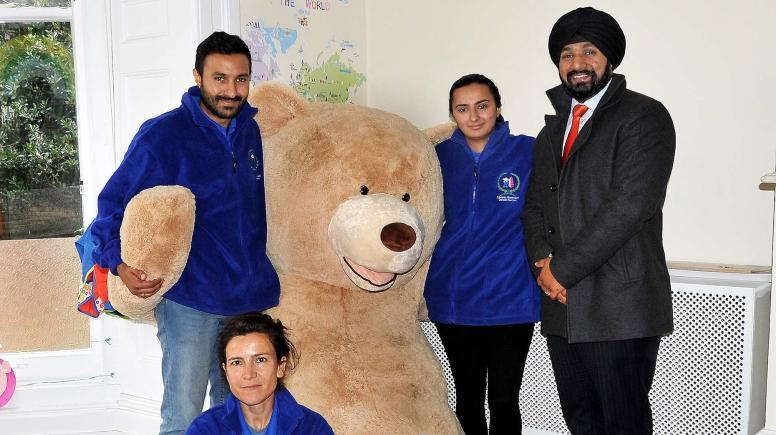 (left to right): Vinay Sidar, Priya Sidar and Banks Long & Co Surveyor Jag Landa, with (foreground) Nursery Practitioner Natlaia Sancho with one of the nursery's young charges.