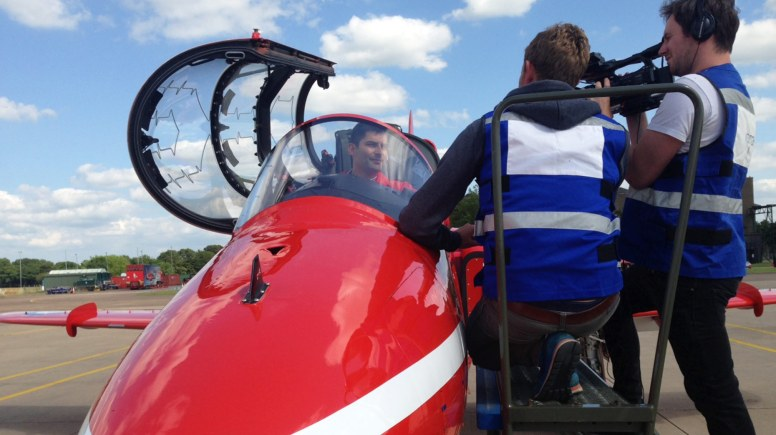 Squadron Leader David Montenegro, Red 1 and Team Leader of the Royal Air Force Aerobatic Team, the Red Arrows, being interviewed by a film crew at RAF Scampton, Lincolnshire, for a new BBC documentary series. Photo: MoD/Crown Copyright 2015