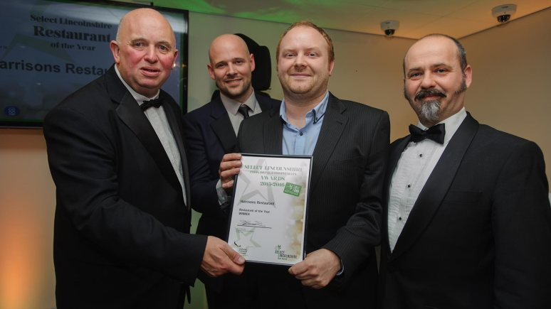 Colin Davie, Executive Councillor for Economic Development, Environment, Strategic Planning and Tourism at Lincolnshire County Council presenting the award for Restaurant of the Year to Harrisons Restaurant. Photo: Steve Smailes for The Lincolnite