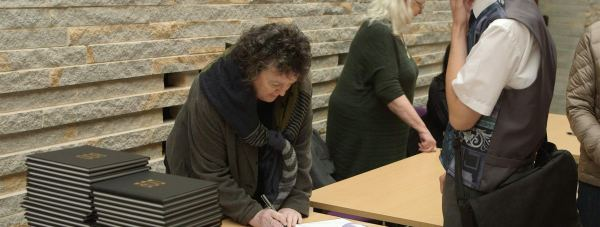 Poet Laureate Carol Ann Duffy signing copies of the book at The Collection in Lincoln.