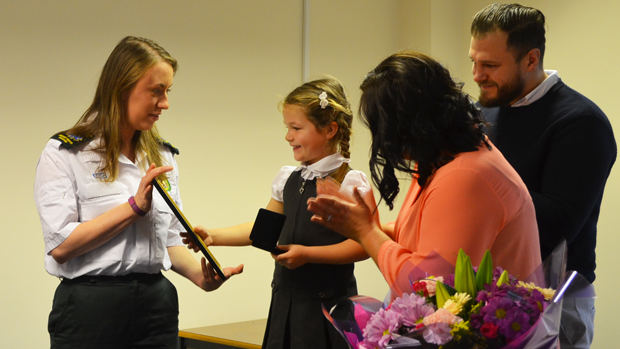 Maya receiving her award for bravery. Photo: Stefan Pidluznyj for The Lincolnite
