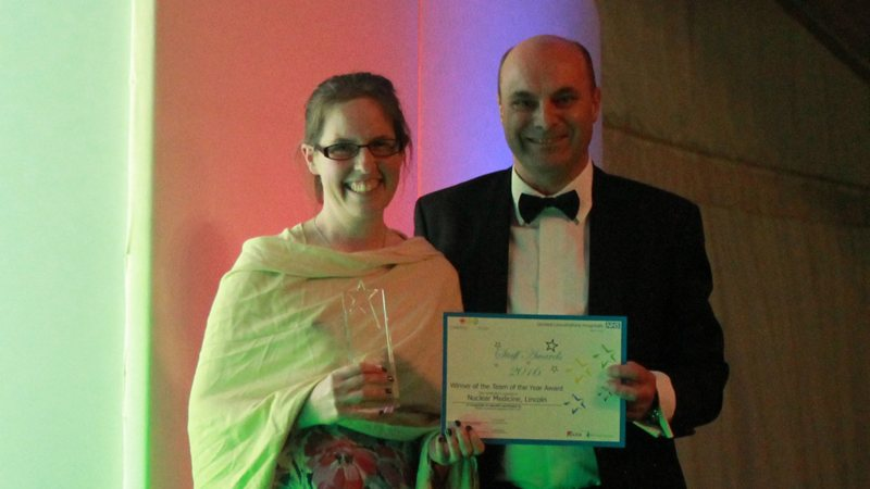 A member of the nuclear medicine team with Director of HR Ian Warren