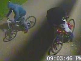 Suspects captured on CCTV fleeing the scene of the robbery on Queen Elizabeth Road on March 13, 2016