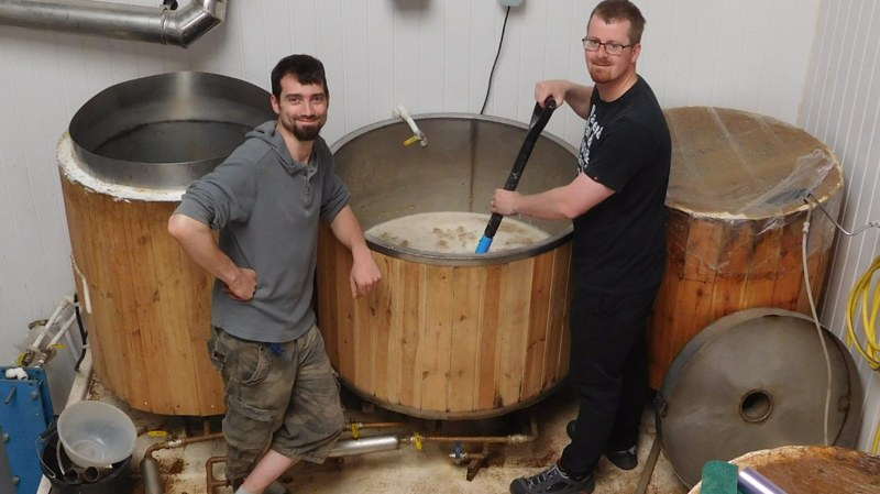 Cathedral Heights brewer, Steve Marston and Lincoln CAMRA committee member, Ashley Sewell, mashing in for the Festival ale.