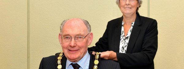 Councillor Gill Ogden handing over the reins as chairman to Councillor John Money. Photo: North Kesteven District Council