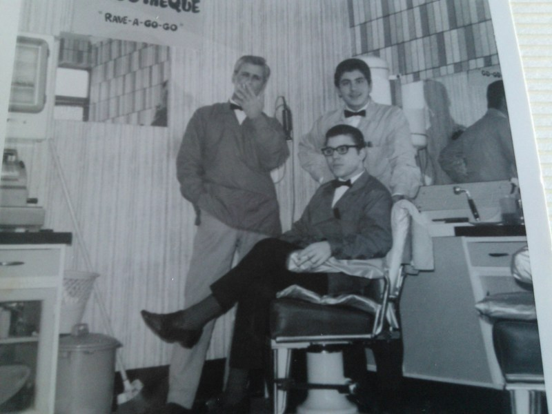 Gino Scumaci with his father and colleague on his first day on the job.