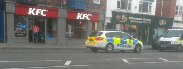 Police at the KFC store on Lincoln High Street. Photo: Nath Riley