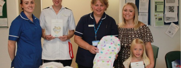 Deputy sister Stacey Raynor, staff nurse Helen Fletcher, ward manager Rachel Wright, staff nurse Jenna Robinson with daughter Ophelia Wilkes. Photo: Lincolnshire Hospitals NHS Trust