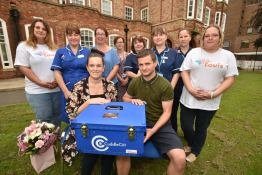 Amanda Naylor and Dan Nicholson presenting the cuddle box to staff at Lincoln County Hospital. Photo: Steve Smailes for The Lincolnite