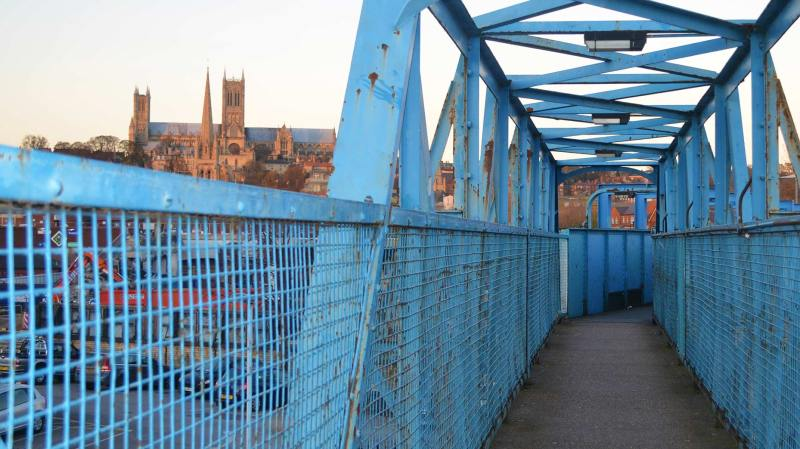 The current footbridge over the railway would be pulled down in the second phase of the project. Photo: The Lincolnite