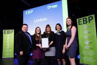Lindum Group collect their award from guest speaker David Hyner, left, Elaine Lilley, chief executive of The EBP, second in from right, and Kayleigh Wells, The EBP's work experience co-ordinator, right. Photo: Chris Vaughan
