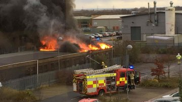 Flames have engulfed the building off Doddington Road. Photo: Glyn Pallister