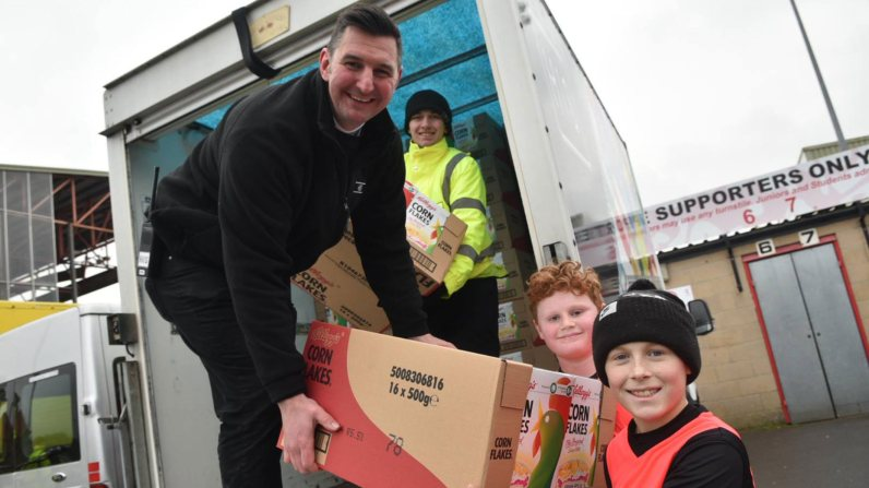Children from Waddington Redwood School receiving cereal. Photo: Steve Smailes for The Lincolnite