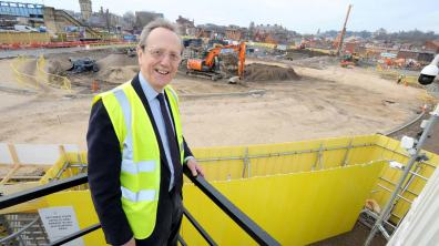 Council Leader Ric Metcalfe watches the piling work at the site of the future Lincoln Transport Hub