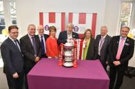 Staff at Bishop Grosseteste University with the sought-after cup. Photo: Steve Smailes for The Lincolnite