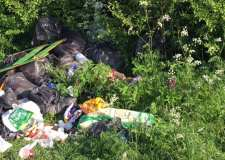 Fly tipping illegal traveller camp moved on