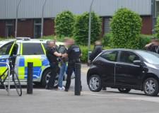 Man arrested by armed police named and charged