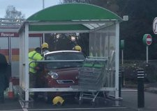 Car smashes into supermarket trolley bay