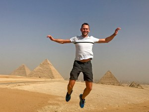 Scott Swiontek jumping in front of the Pyramids of Giza, Cairo, Egypt.