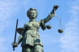Lady Justice seeks justice against ne'er-do-wells