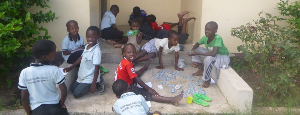 Lion of Judah Academy - boys playing in front of house