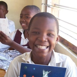 Lion of Judah Academy - Girl Smiling in Class