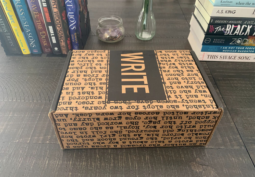 Scribbled subscription box unopened on a table