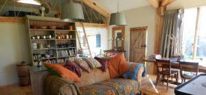 quirky accommodation with canopy and stars comfy-sofa-in-the-arc-cabin-cambridgeshire_cs_gallery_preview