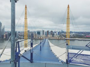 climbing over the o2 / up at the o2