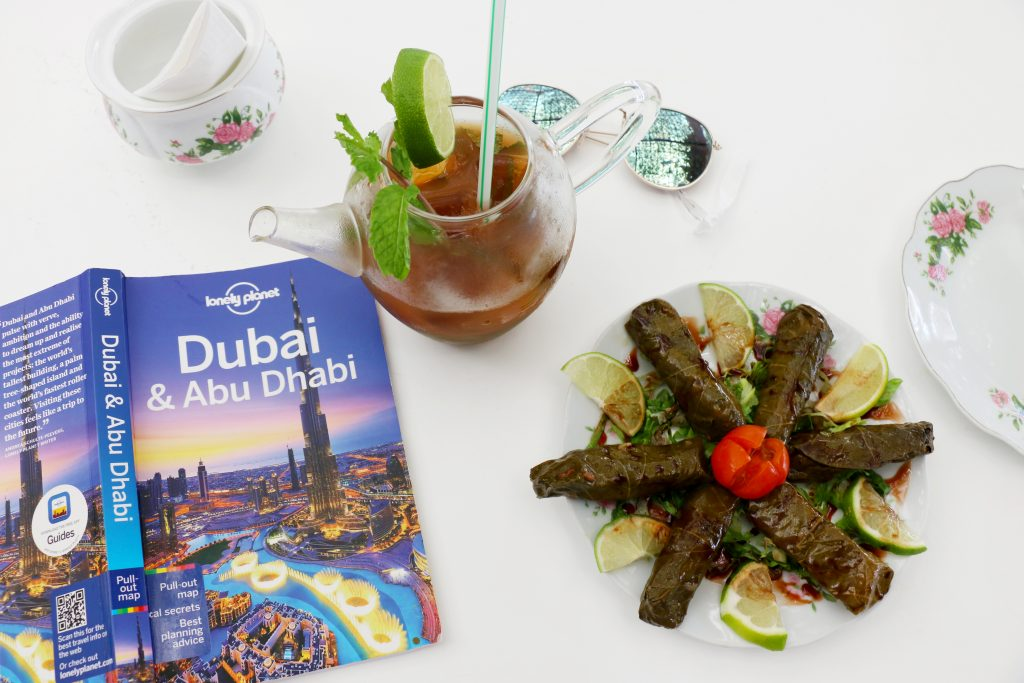 flat lay of tea and food at Arabian Tea House - things to do in Dubai