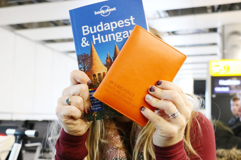 Why you should embrace a layover - passport cover and Lonely Planet