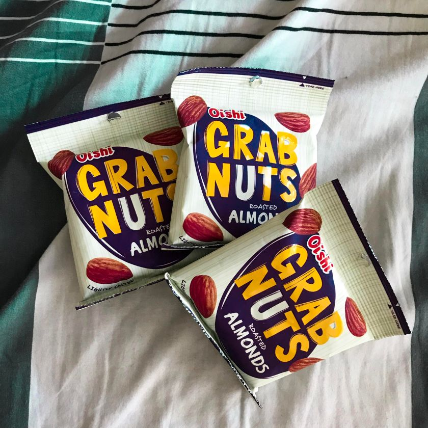 Grab a pack of Oishi Grab Nuts Roasted Almonds to satiate your hunger.