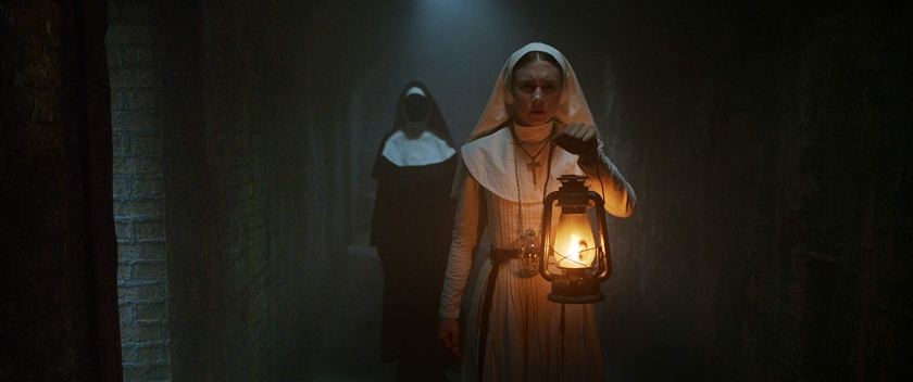 Taissa Farmiga escapes the horrors of Valak in The Nun. | Credit: Warner Bros Pictures