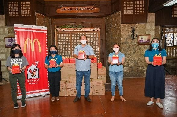 Turnover ceremonies in Rizal (left) and Marikina (right). | Make A Child Happy With Every McDonald's Happy Meal This Holiday | The Little Binger