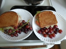 Buttered+skillet-toasted grilled ham+turkey+cheese sandwiches with lettuce and tomato, and GRAPES!