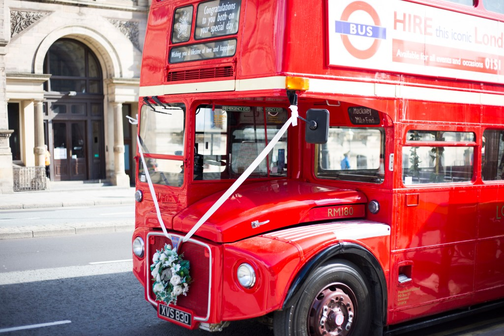Red double-decker bus for wedding transportation