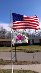 Billy's big project: planting a flag pole and flying these 2 powerful flags...