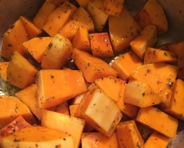 butternut squash in pot with herbs and spices