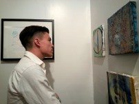 David Arms looking at work by Danielle Lange