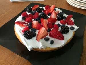 """Made this Coconut Cornmeal cake for a co-workers birthday. Topping is Coconut """"Whipped Cream"""" and it's a good thing I made extra. We were all just globbing it on..."""