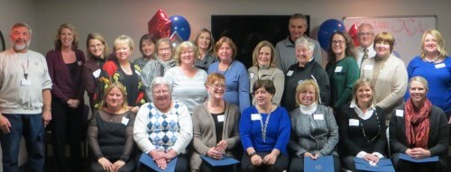 CASA volunteers honored at the event pose for a photo along with The Hon. Miriam Cavanaugh and The Hon. David Reader; Renee Adorjan, director of the Livingston County Department of Health & Human Services; LACASA President and CEO Bobette Schrandt; CASA Director Sara Applegate; and CASA Supervisor Melanie Cattermole.